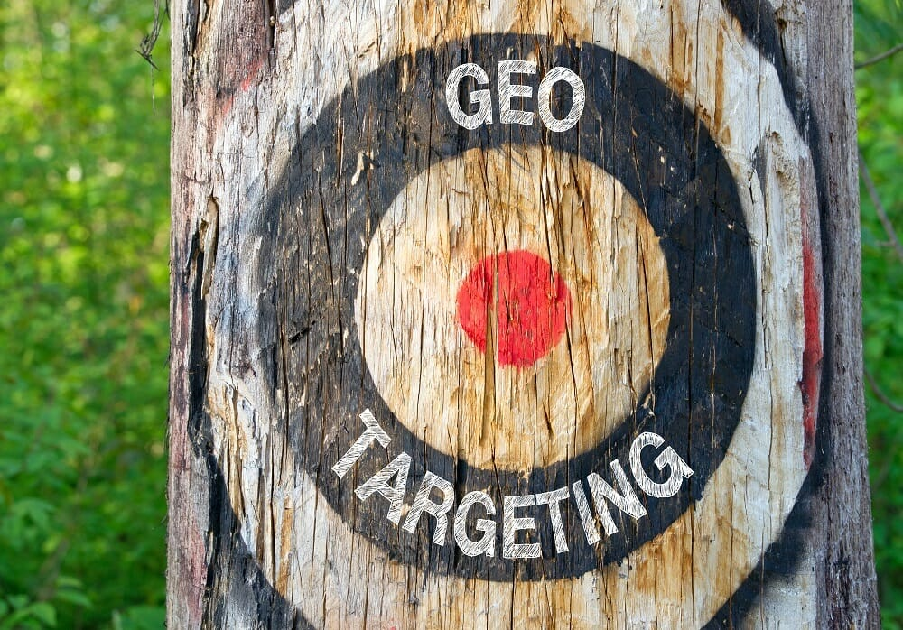 Geo Targeting - tree with target and text in the forest - Geotargeting, Geomarketing, Geolocation